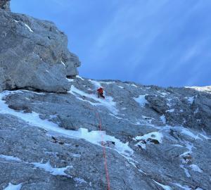 Callum setting off on the crux ice pillar...